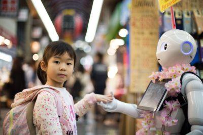 Asian child with robot